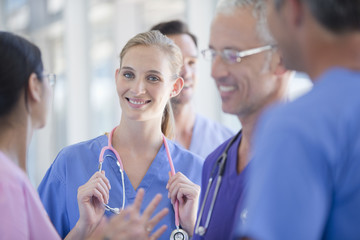 Portrait of smiling doctor among co-workers