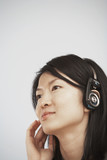 Mid-Adult Woman Listening to Headphones
