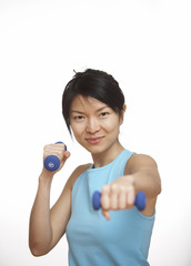Mid-Adult Woman Working Out with Dumbbells