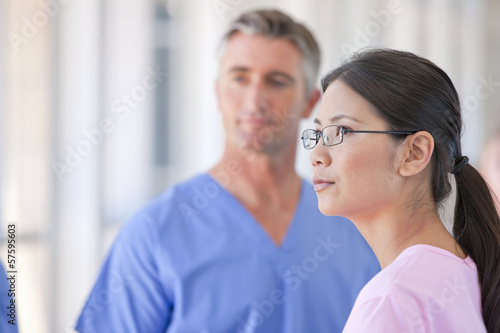 Close up of nurse listening to doctor