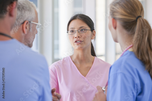 Close up of serious doctors and nurse talking