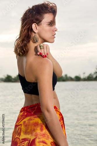 Profile of woman in the beach