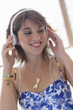 Close up of smiling young woman wearing headphones