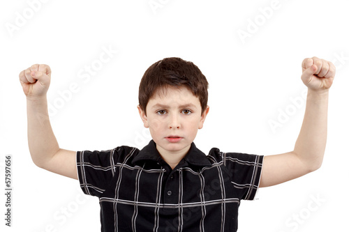 Portrait of a young boy with hand raised up