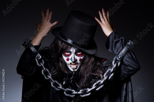 Monster chained in dark room