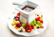 Chocolate fondue with fresh fruits and berries