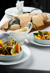 Baked whole fish in a salt crust served with vegetable salad