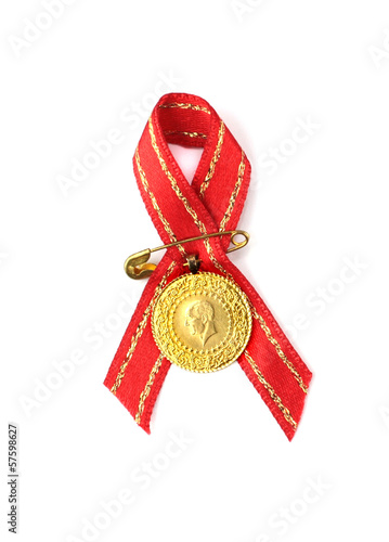 Turkish traditional gold coin with red ribbon. ( Quarter gold )