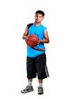 Young asian boy standing with basketball
