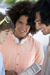 Close up portrait of smiling friends using digital tablet