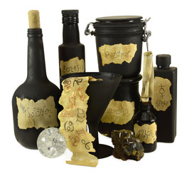 Black bottles with Zodiac symbols on paper