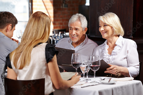 Senior couple with family in restaurant