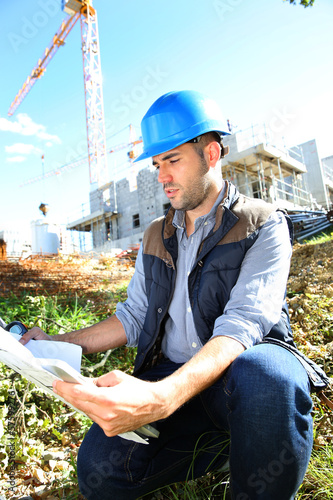 Construction manager using walkie-talkie on site