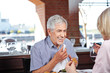 Elderly man with napkin at restaurant