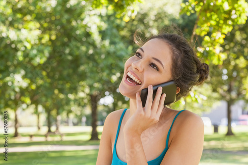 Happy young woman phoning with her smartphone