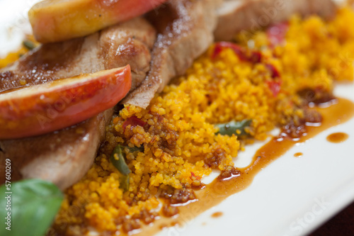Close up of couscous with meat and apple