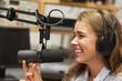 Laughing pretty radio host moderating - 57600600