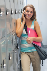Smiling pretty student phoning