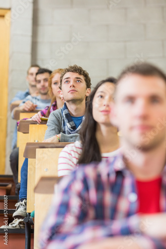 Close-up of young students sitting in classroom
