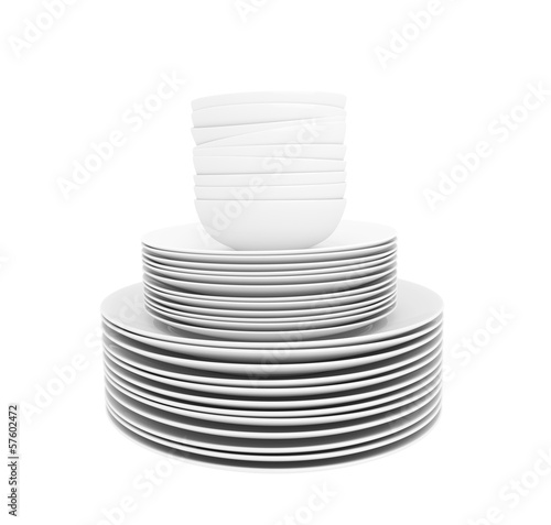 Stack of white dishes and soup bowls isolated on white