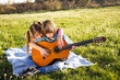 Children play guitar