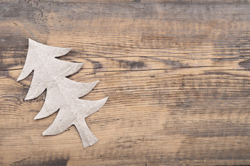 Christmas tree made of gray paper on wood background
