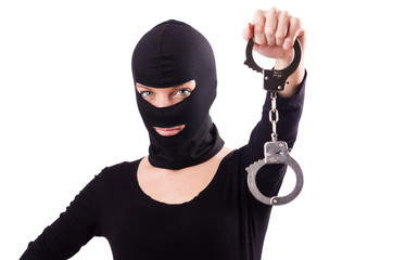Young female criminal with handcuffs