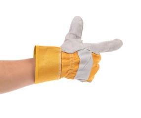 Hand in gloves holds as gun.