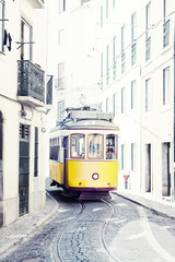 yellow ancient tram on streets of Lisbon, Portugal
