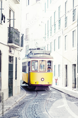 yellow ancient tram on streets of Lisbon, Portugal - 57603687