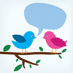 two birds with message bubble sitting on a tree branch