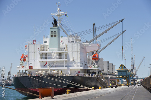 Cranes loading container ships at commercial dock