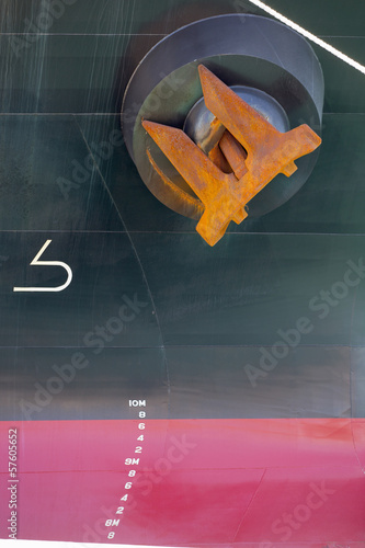 Close up of anchor in hull of container ship