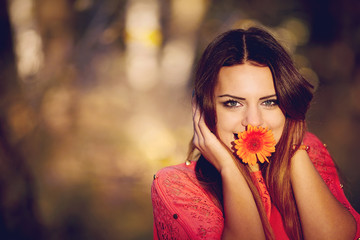 Girl with a flower in his mouth