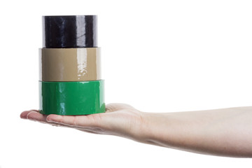 Hand holding tower made of adhesive tape