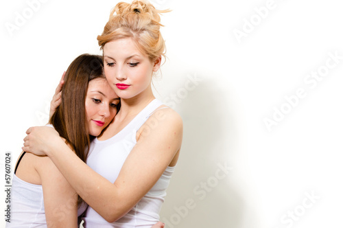 Two female friends hug of comort