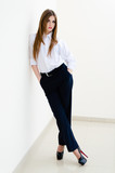 Fashion young business woman wearing man's shirt on white