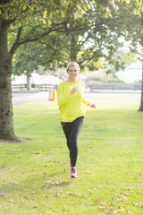Active smiling blonde jogging towards camera