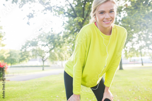 Active cheerful blonde pausing after a run