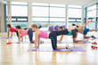Women stretching on mats at yoga class