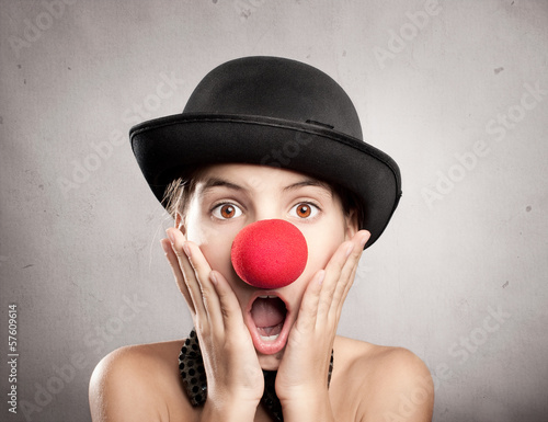 surprised little girl with a red nose