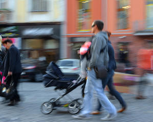 Parents walks with the child in the stroller