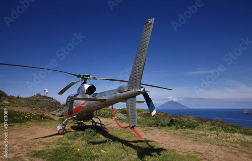 Italy, Sicily, Aeolian Islands, Panarea, helicopter in a field