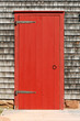 Wooden red door of the traditional New England house