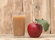 apple with apple juice on a wooden background