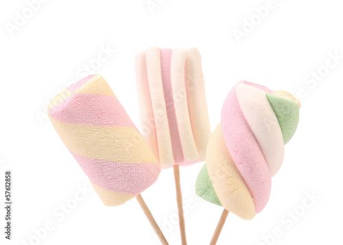 Three different colorful marshmallow on sticks