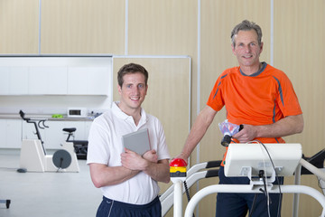 Portrait of sports scientist and runner on treadmill in laboratory