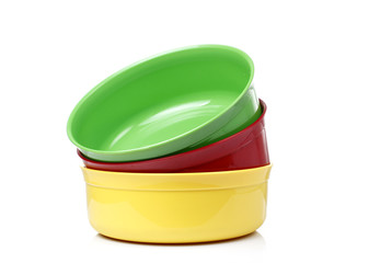 Colorful plastic bowls on White background