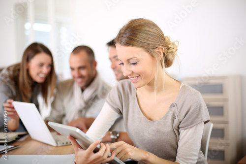 Young business girl working on tablet