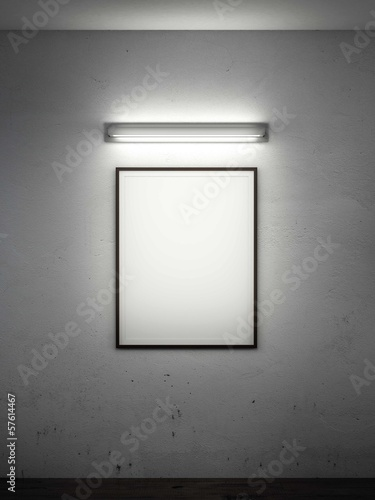 frame on wall with lamp in dark room